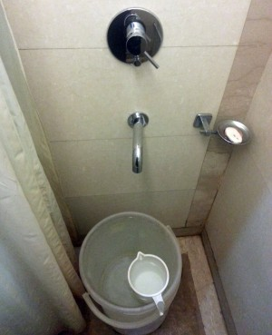 """Cold water only in this 3-star Indian """"shower""""."""