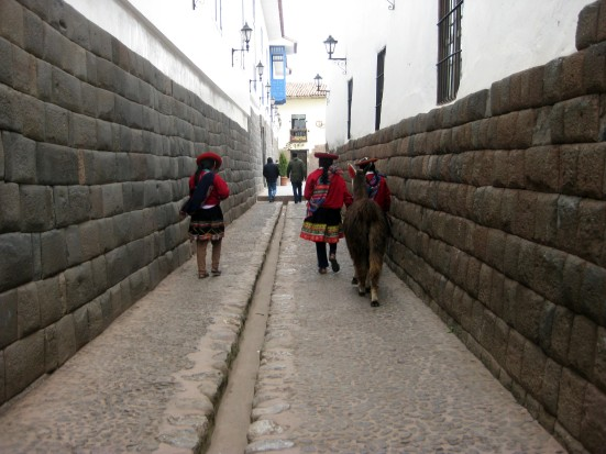 Schoolgirls walking through Cusco with their llama.
