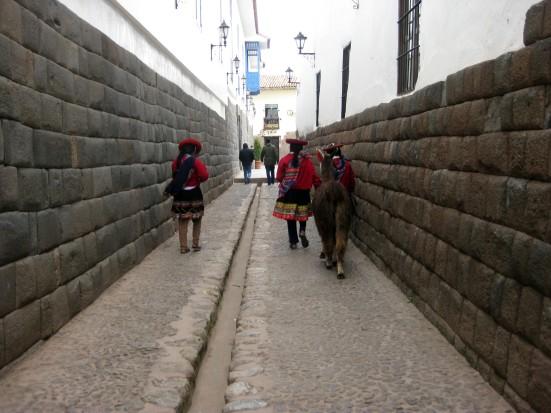 Schoolgirls walking through Cusco with their llama.