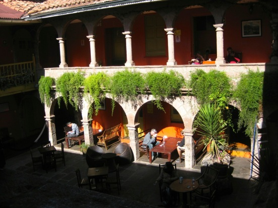Ecopackers courtyard where guests read, socialize, eat and nap. Cusco, Peru.