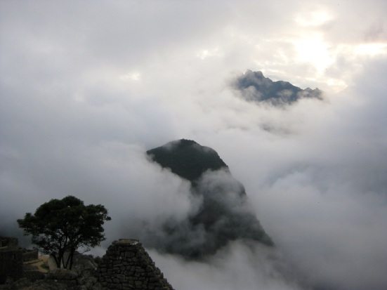 Andes mountaintops surrounded by early fog.