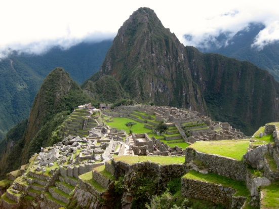 Fog has cleared for the moment as the sun shines on Machu Picchu.