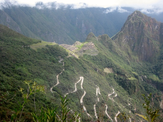 View from Machu Picchu from the Sun Gate. The zig-zag road is what the buses take from Aguas Calientes.