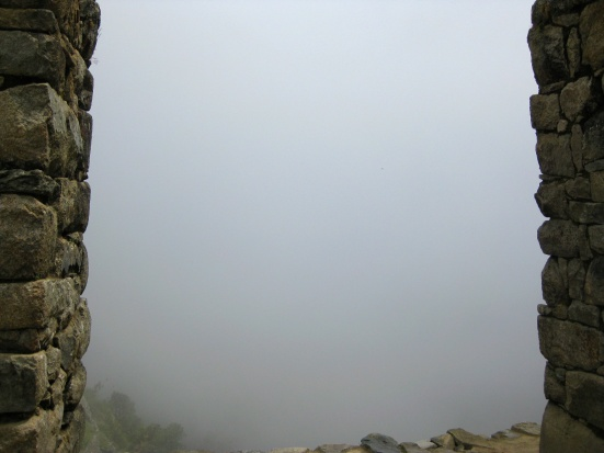 The view I hiked so far for: Machu Picchu fog from the Sun Gate