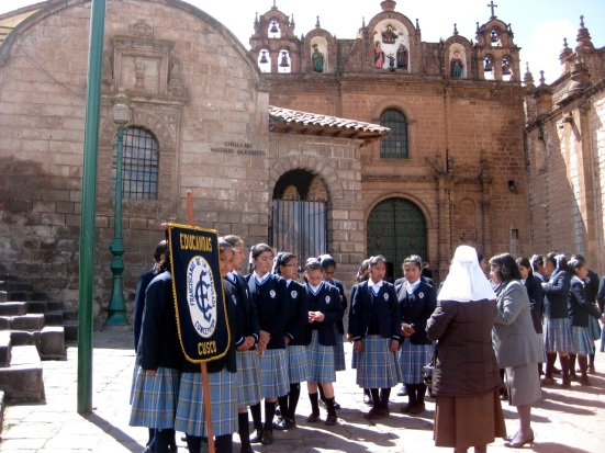 Schoolgirls outside the Cathedral of Santo Domingo .